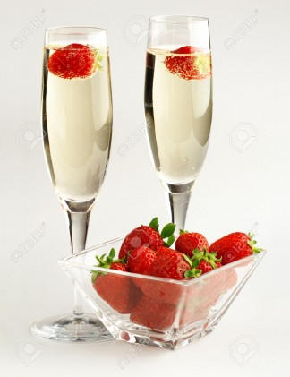 champagne-glasses-and-strawberries-on-white-background-Stock-Photo