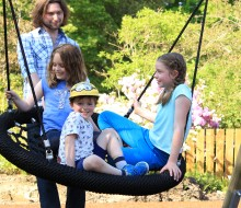 Children playing on the swing at Glendoick Playpark